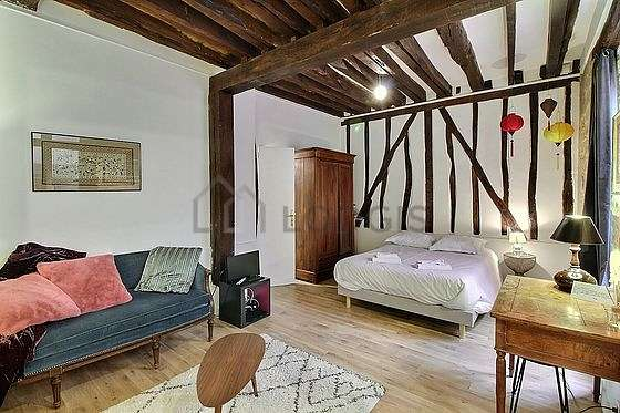 Very quiet living room furnished with 1 bed(s) of 140cm, sofa, 1 armchair(s), 2 chair(s)
