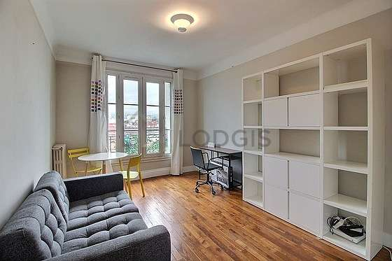 Very quiet living room furnished with tv, 1 chair(s)