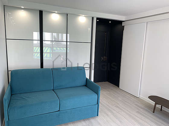 Very quiet living room furnished with 1 sofabed(s) of 140cm, sofa, coffee table, wardrobe