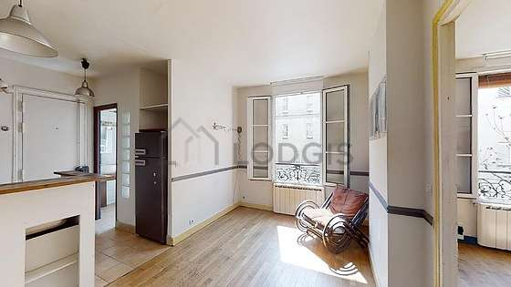 Very quiet living room furnished with sofa