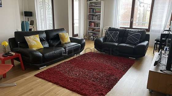 Very quiet living room furnished with tv, hi-fi stereo, 1 armchair(s), 1 chair(s)