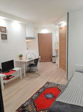 Quiet living room furnished with 1 bed(s) of 90cm, tv, wardrobe, cupboard