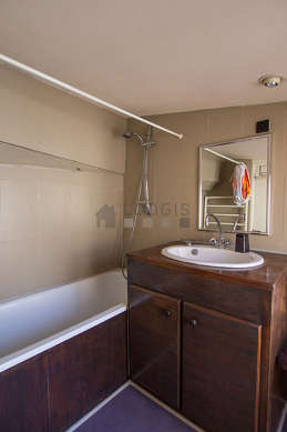 Beautiful and bright bathroom with double-glazed windows and with woodenfloor