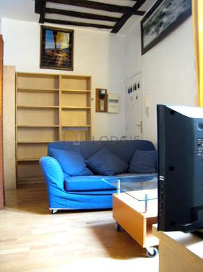 Very quiet living room furnished with tv, hi-fi stereo