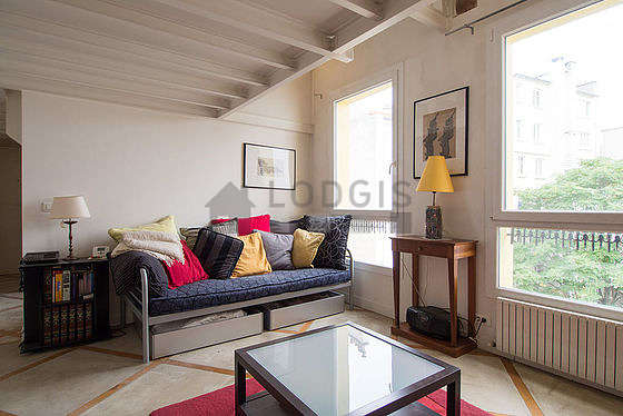 Quiet living room furnished with 1 sofabed(s) of 90cm, tv, 2 armchair(s), 4 chair(s)