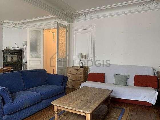 Grand salon de 33m² avec du parquetau sol