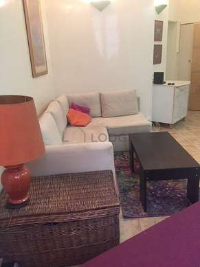 Living room furnished with 1 sofabed(s) of 140cm, tv, wardrobe, cupboard