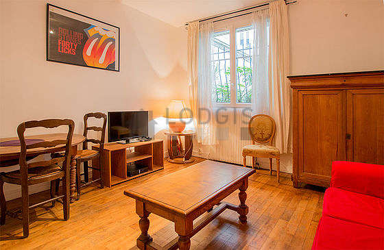 Very quiet living room furnished with 1 sofabed(s) of 140cm, hi-fi stereo, wardrobe, cupboard