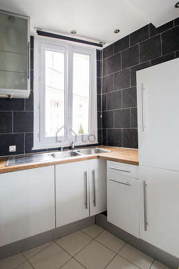 Kitchen where you can have dinner for 3 person(s) equipped with washing machine, refrigerator, crockery, stool