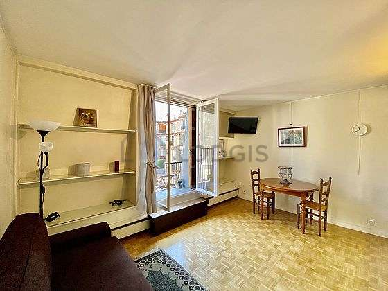 Quiet living room furnished with 1 sofabed(s) of 120cm, tv, cupboard, 4 chair(s)