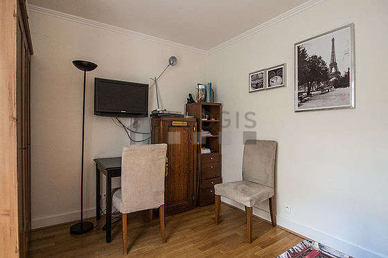 Living room furnished with cupboard, 2 chair(s)