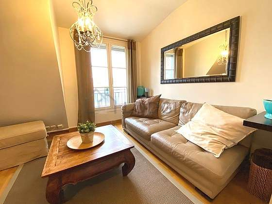 Very quiet living room furnished with 1 bed(s) of 140cm, tv, hi-fi stereo, wardrobe