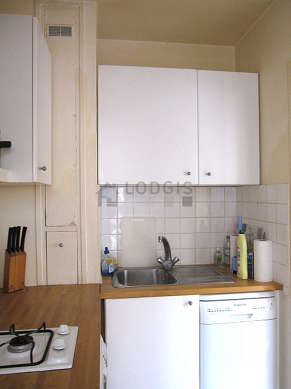Very bright kitchen with double-glazed windows and balcony facing the road