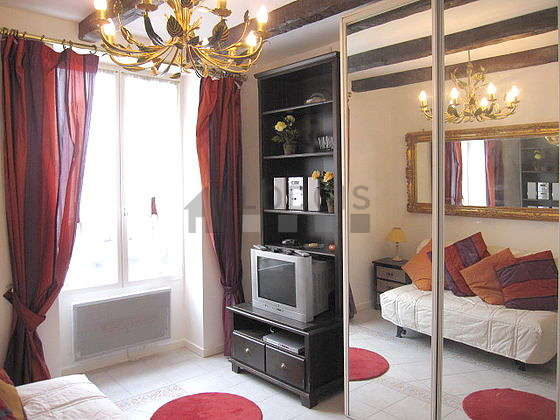 Bright bedroom equipped with tv, hi-fi stereo, bedside table