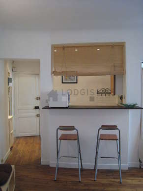 Beautiful kitchenopens on the living room with tilefloor
