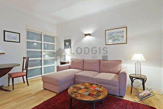 Very quiet living room furnished with tv, hi-fi stereo, 4 chair(s)