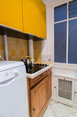 Bright kitchen with windows facing the courtyard