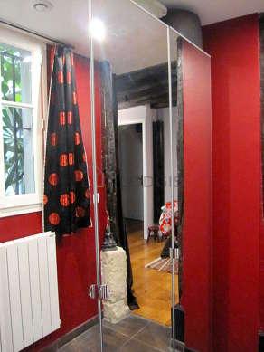 Very quiet walk-in closet with tilefloor