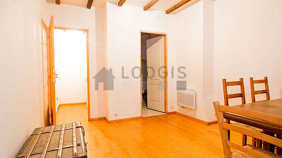 Dining room with woodenfloor for 4 person(s)