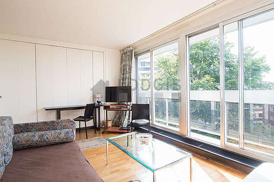 Living room with windows facing the garden