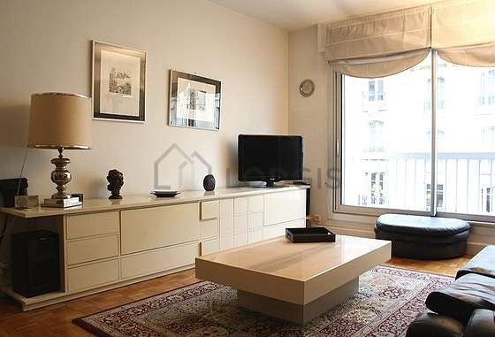 Living room furnished with tv, hi-fi stereo, wardrobe, cupboard