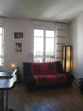 Quiet living room furnished with 1 futon(s) of 160cm, tv, hi-fi stereo, wardrobe