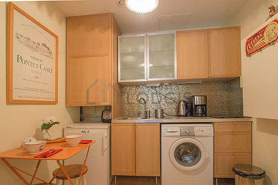 Kitchen where you can have dinner for 3 person(s) equipped with washing machine, refrigerator, freezer, crockery