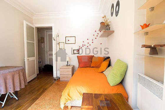 Living room furnished with 1 sofabed(s) of 90cm, dining table, wardrobe, cupboard