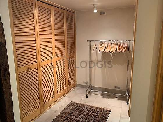 Beautiful dressing-room serviced with : wardrobe, cupboard, rack