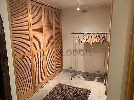 Beautiful dressing-room serviced with : wardrobe, cupboard, rack