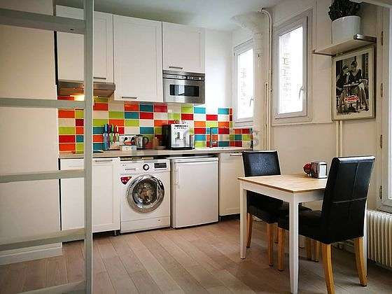 Kitchen where you can have dinner for 2 person(s) equipped with washing machine, dryer, refrigerator, extractor hood