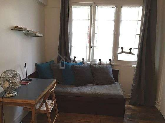 Living room furnished with wardrobe, cupboard, 2 chair(s)
