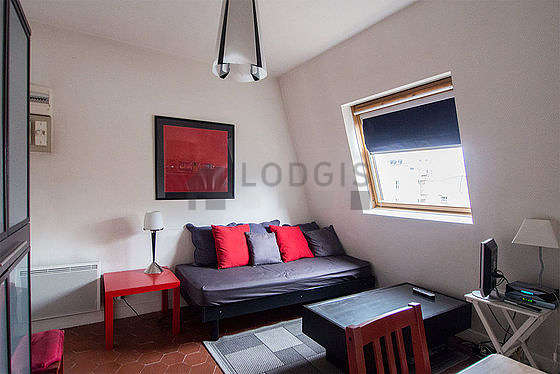 Very quiet living room furnished with 1 bed(s) of 90cm, tv, closet, 2 chair(s)