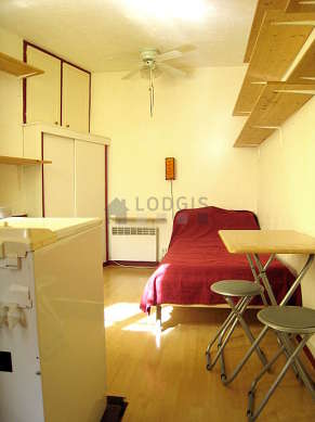 Quiet living room furnished with 1 bed(s) of 90cm, wardrobe, cupboard