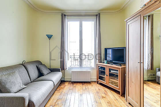 Very quiet living room furnished with 1 sofabed(s) of 140cm, tv, closet, 2 chair(s)