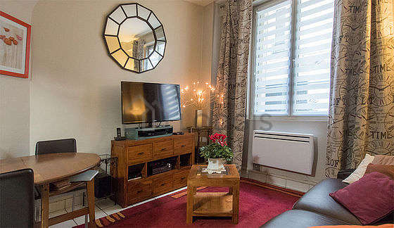 Quiet living room furnished with 1 sofabed(s) of 140cm, tv, hi-fi stereo, 4 chair(s)