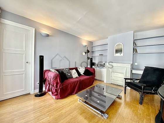 Very quiet living room furnished with home cinema, tv, hi-fi stereo, 1 armchair(s)