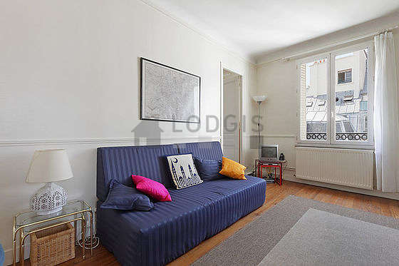 Very quiet living room furnished with 1 bed(s) of 90cm, tv, 3 chair(s)