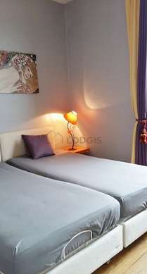 Bright bedroom equipped with desk, wardrobe, cupboard, 2 chair(s)