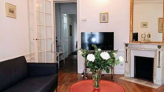 Living room furnished with tv, dvd player, 2 chair(s)