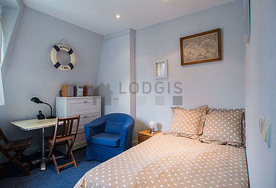 Very quiet living room furnished with 1 bed(s) of 120cm, tv, hi-fi stereo, 1 armchair(s)