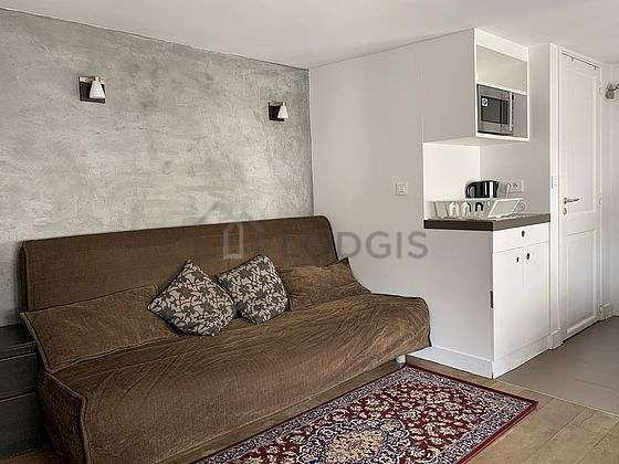 Quiet living room furnished with 1 sofabed(s) of 140cm, tv, wardrobe, 2 chair(s)