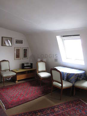 Quiet living room furnished with 1 sofabed(s) of 160cm, 1 armchair(s), 5 chair(s)