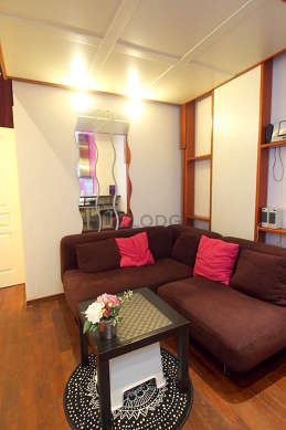 Quiet living room furnished with 1 murphy bed(s) of 140cm, tv, hi-fi stereo, wardrobe