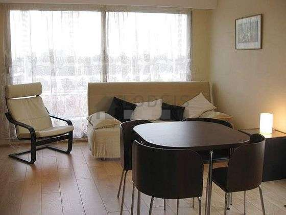 Living room furnished with 1 sofabed(s) of 140cm, tv, 1 armchair(s), 5 chair(s)
