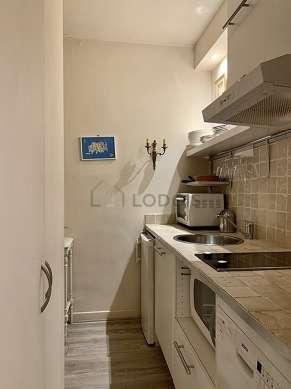 Beautiful kitchen with the carpetingfloor